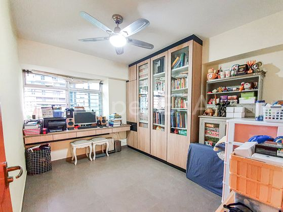 study room with built-in work desk and ceiling height cabinet